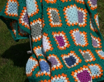 Sacha : Little new afghan blanket, crocheted granny squares.