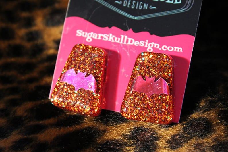 CLEARANCE Orange Sparkle with purple bats Post Earrings  image 0