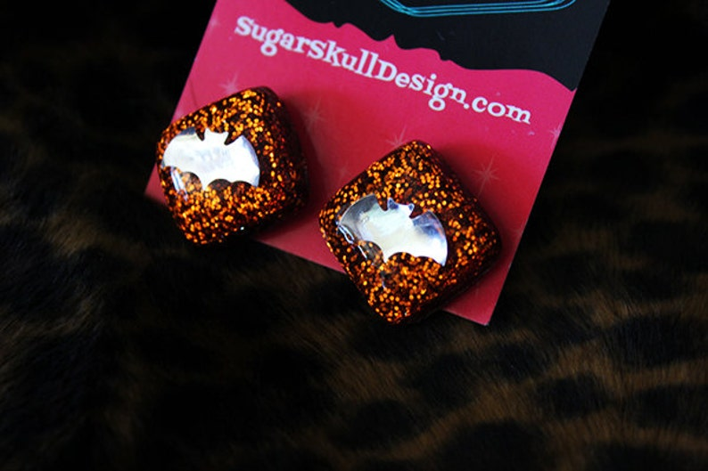 CLEARANCE Orange Sparkle with Silver Bats Resin Post Earrings image 0
