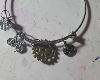 Stainless steel bangle bracelets.  Bikes. Cogs. Bike riders. 2/8.00