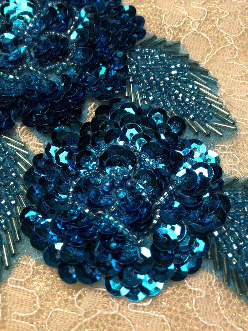 Turquoise beaded and sequined applique pair   237