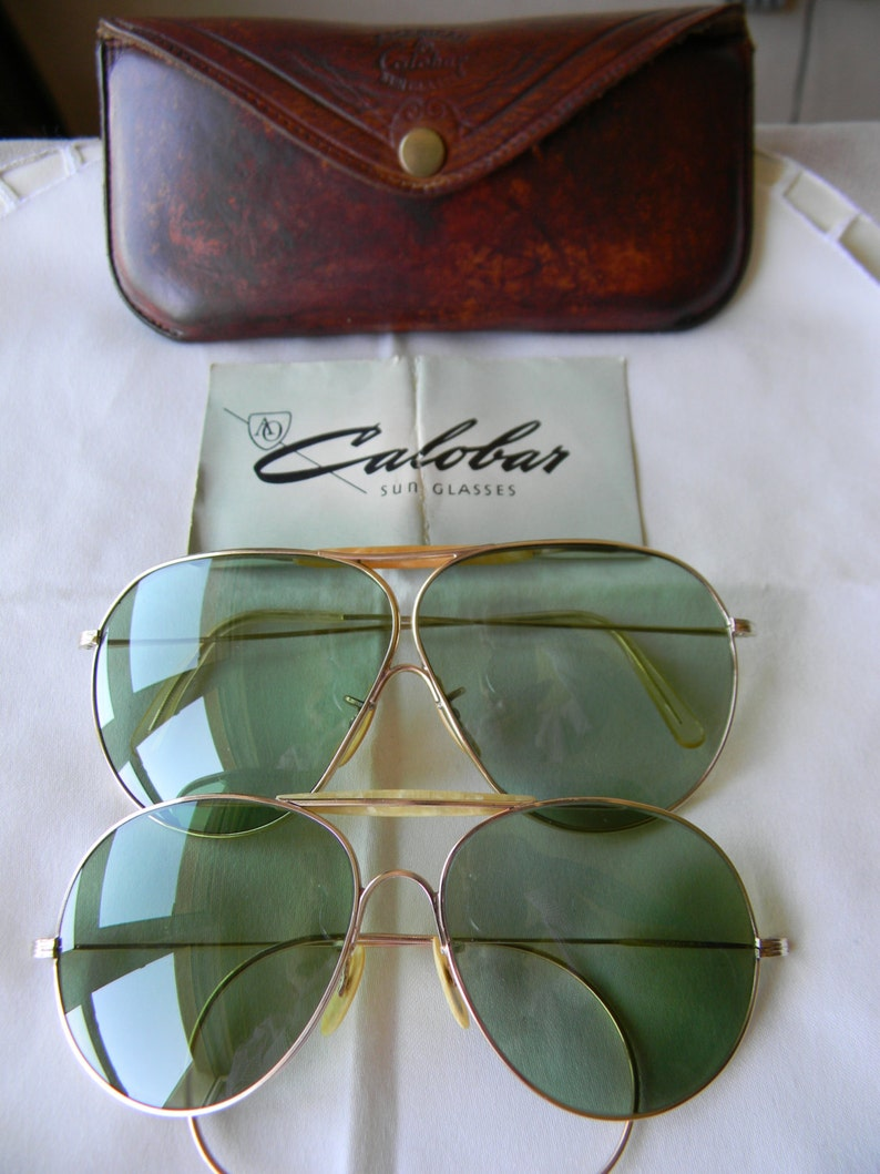 7a84624e81 Two Pairs of Vintage American Optical Calobar sunglasses AO