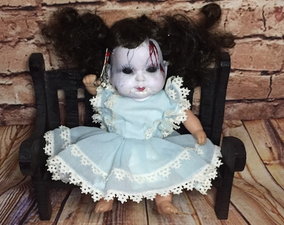 Doll Face Undead Party Dressed Black Eyed Serial Killer Scissor Wielding Bench Sitting Biohazard Baby