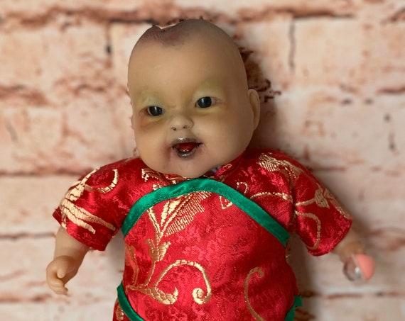 Undead Head Trauma Asian Traditionally Dressed Zombie Brain Exposed Biohazard Baby