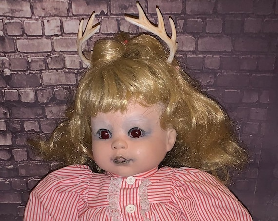 Original Undead Fantasy Animal Antler Biohazard Baby Dressed For Bed With Her Mini Undead Noosed Meat Eating Human Biohazard Baby Doll