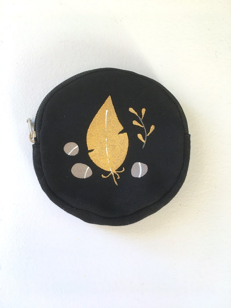 with Gold Feather and Lucky Rocks design Round Black Canvas Coin Purse