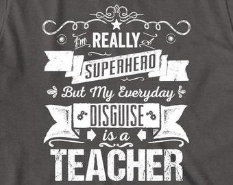 I'm Really A Superhero But My Everyday Disguise Is A Teacher Shirt - gift idea, teacher assistant, teacher graduate - ID: 1726