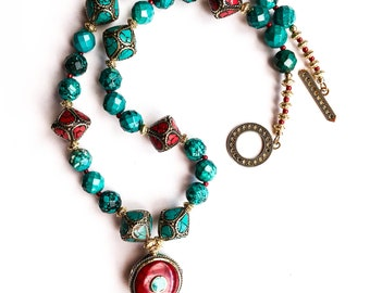 2018_NE_005: Faceted turquoise beads, Nepalese beads and pendants, and gold toned spacers