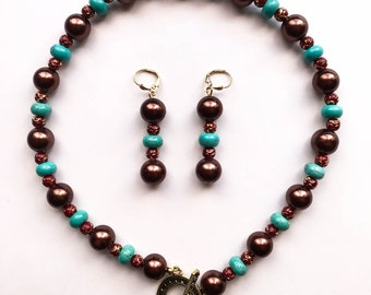 2018_NE_009: Maroon glass pearls, magnesite rondelles and red/gold spacers