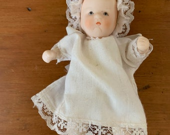 Bisque Baby Doll, Hinged Mini Bisque Baby, Vintage Infant 4.5 Inch Ceramic Doll with Dress and Cap, Doll Lover Gift
