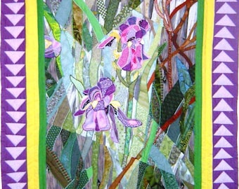 "Iris Medley - A Fractured Landscape Quilt, measuring 43"" X 56"" depicts two irises in pink, purple and yellow shades amidst a woodland scene"