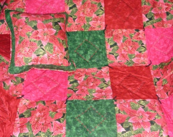 "Poinsettia Magic...Caring Quilt Set...with one lap quilt at 44"" x 52"", hand-tied and machine embroidered, plus a matching 14"" x 14"" pillow"