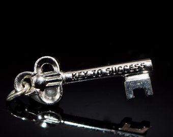 Vintage sterling silver key to success charm