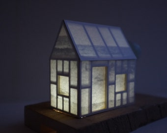 Hidden seas house - lighted paper house - small architectural structure on reclaimed wood base