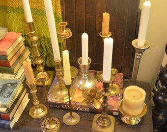 Lot of eleven brass and two silver metal vintage candlestick holders patina