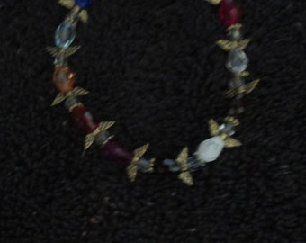 Delicate, glass beaded bracelet with silver / brass