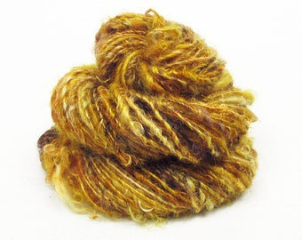 Handspun Single, from Kid Mohair dyed shades of brown, gold and amber with banana silk accents