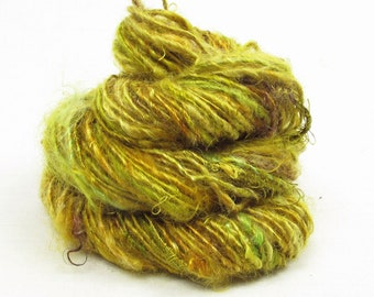 Handspun Single, from Kid Mohair dyed shades of green and gold with banana silk add-ins
