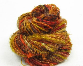 Handspun Single, from Kid Mohair dyed shades of brown, gold and red with banana silk add-ins