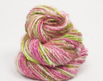 Handspun Single, from Kid Mohair dyed shades of pink and chartreuse, with natural locks added.