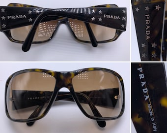 8bb9df340601 PRADA Oversized Round Lens Sunglasses with Silver Star Shaped Hardware