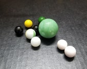 Jadeite Green Shooter Marble, Boulder, Bonker, Masher, Large Glass Marble, 1 Peltier NLR Flaming Dragon Marble, Assorted Small Marbles