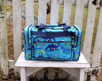 0e80778ba9c7 Dinosaur Duffel Bag