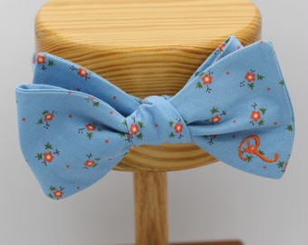 All Cotton Baby Blue Self Tie Bow Tie with Orange Daisies