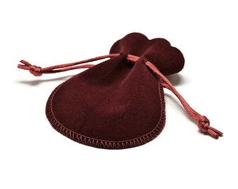 Red faux velvet pouch bag