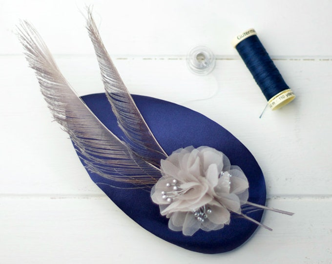 Caerlaverock - Silk Blue Fascinator with detail of organza flowers and peacock feathers
