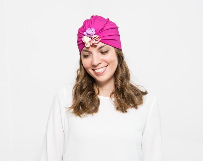 Abi - Fuchsia hair turban with detail of clay flowers