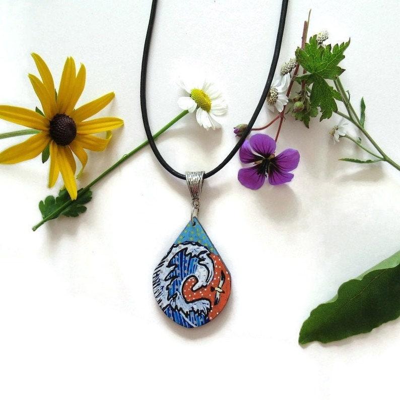 Painted wooden teardrop flying bird sea waves necklace pendant image 0