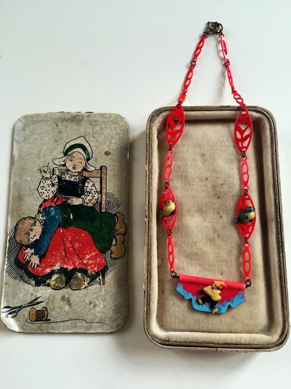1930's novelty bakelite children's necklace in its