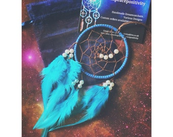 Blue dream catcher, faux suede, brown web with blue rooster feathers and pearl bead spiral finish 7cm diameter - dreamcatcher hand made