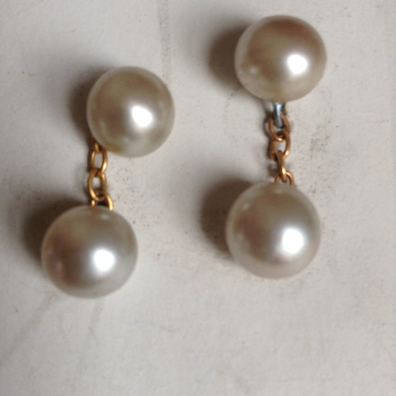 1950\u2019s cufflinks and neck buttons.