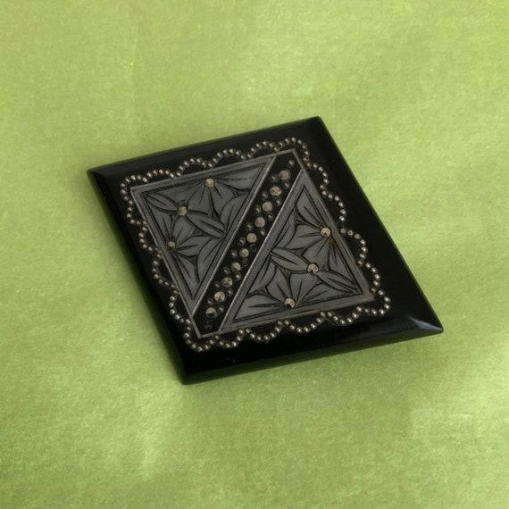1930's black brooch.