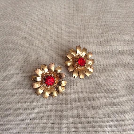 "1960's ""daisy"" clip-on earrings."