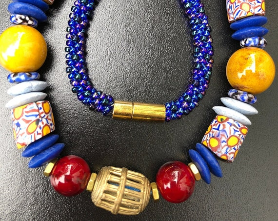 Kente TradeWinds Necklace, blue yellow burgundy Kumihimo/ beaded braids/ Krobo beads/ antique Millefiore trade beads/ Japanese Toho beads