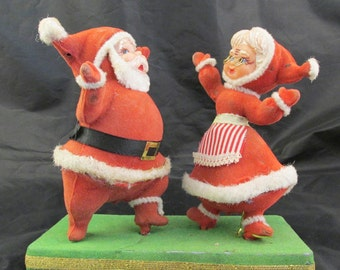 Flocked Plastic Mr and Mrs Santa Claus Dancing on a  Green Base 1950s