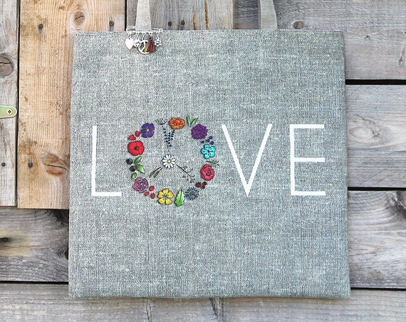 "Featuring natural linen tote bag with ""LOVE"""