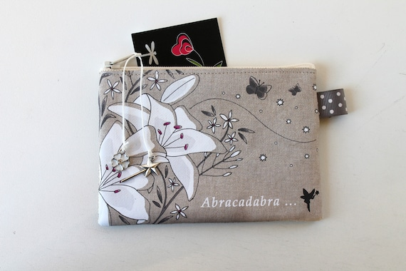 "Wallet featuring ""Abracadabra"" natural linen"