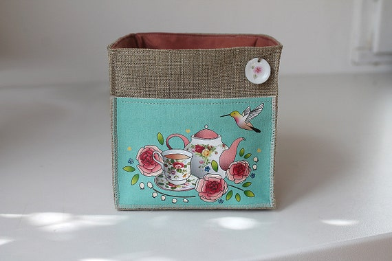 Square teapot shown natural linen basket roses antique and Hummingbird