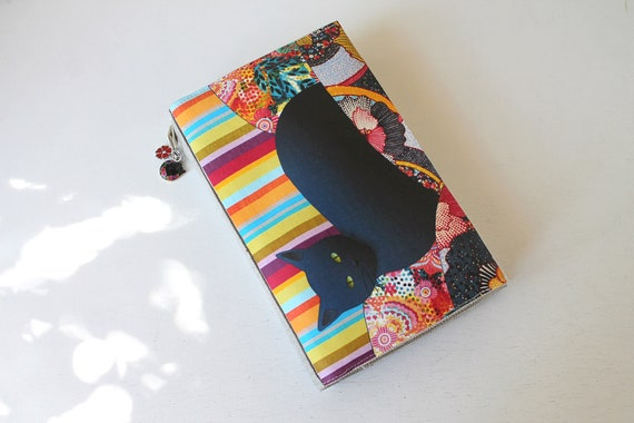"Protects linen pocket book illustrated ""black multicolored cat"""