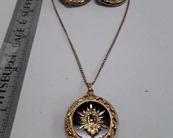 "Gold toned star burst necklace 16"" and earrings set used"