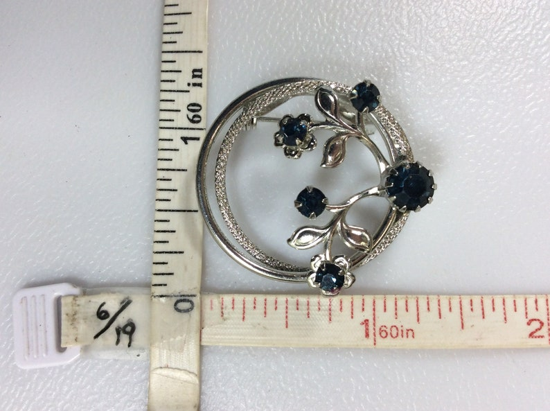 Vintage Silver Toned Pin Brooch Circle With Flowers And Blue Rhinestones Used