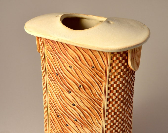 Tall Flattened Oval Stele Vase, Stoneware with Matte Vanilla Cream Glaze and Unglazed Texture Stained with a yellow-brown pigment