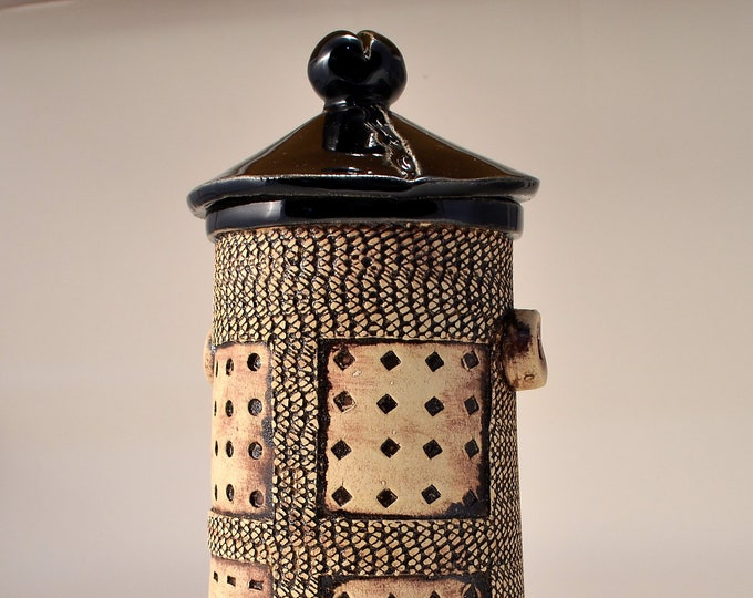 Tall Textured Covered Jar, Lighthouse shaped- Black Gloss Glaze with Textured Outside Stained with green-brown Pigment