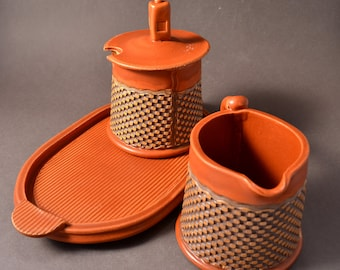Sugar and Cream Set Satin Paprika Red Glaze With Red-Brown Stain wiped back on a geometric pattern by Tom Bottman