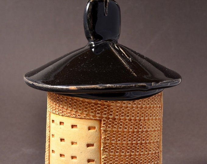 Medium Textured Covered Stoneware Jar, Lighthouse shaped- Gloss Balck Glaze with Textured Outside with Yellow-Brown Stain Rubbed Back