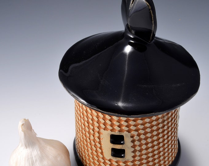 Short Textured Garlic Keeper, Lighthouse shaped- Black Gloss Glaze with Textured Outside Featuring Yellow Stain Rubbed Back by Tom Bottman